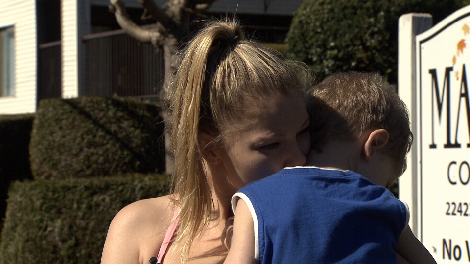 Melissa Cook says she screamed in horror when she turned to see her son Kesler holding a needle outside their apartment building. (CTV)