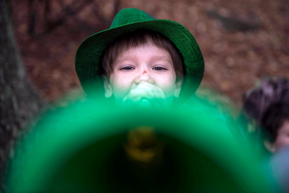 Deacon Fetterman blows a trumpet on the corner of Lafayette Square during the St. Patrick's Day Parade Thursday, March 17, 2016, in Savannah, Ga. (Josh Galemore / Savannah Morning News via AP)