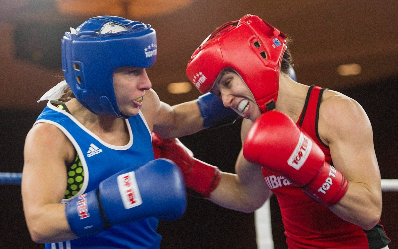 Mandy Bujold, right, of Ontario, trades blows with Kim Klavel, of Quebec, during their 51kg bout at the Canadian Olympic boxing trials, in Montreal on Dec. 9, 2015. (Graham Hughes / The Canadian Press)