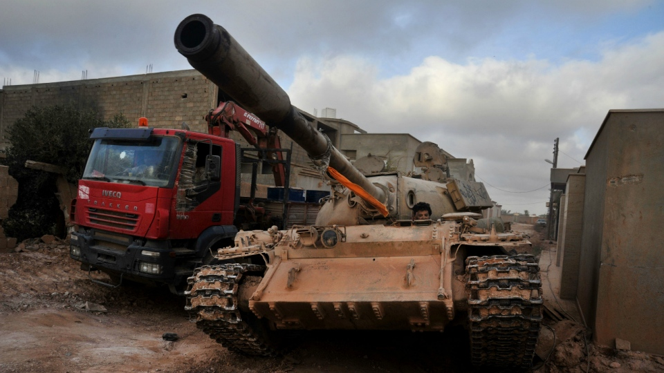 A man loyal to the Libyan armed forces sits in a tank during clashes with Islamic State group militants west of Benghazi, Libya on Monday, March 7, 2016. (AP / Mohammed el-Shaiky)