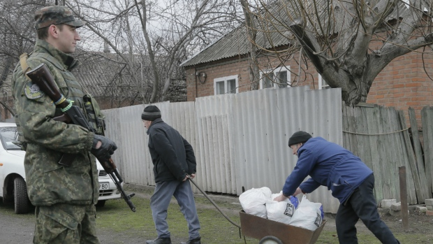 Ukrainian soldiers distribute aid for citizens