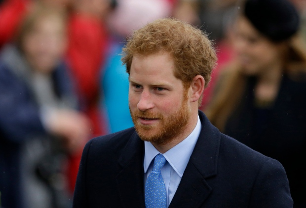 In this file photo dated Friday, Dec. 25, 2015, Prince Harry arrives to attend the family traditional Christmas Day church service, at St. Mary Magdalene Church in Sandringham, England. (AP Photo/Matt Dunham, FILE)