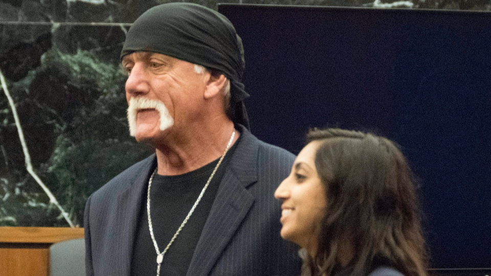 Former professional wrestler Hulk Hogan, left, along with attorney Seema Ghatnekar, appear in a St. Petersburg, Fla., court on Friday, March 18, 2016. (Boyzell Hosey/The Tampa Bay Times via AP)