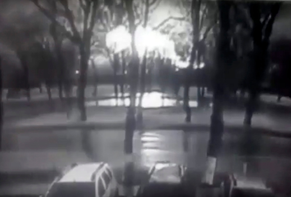 This frame grab provided by Rostov-on-Don I General company from black and white CCTV footage shows road and behind line of trees fireball, believed to be a plane on fire, crashes to ground at the Rostov-on-Don airport, about 950 kilometers (600 miles) south of Moscow, Russia Saturday, March 19, 2016. (Rostov-on-Don I General company via AP)