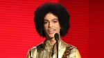 Prince presents the award for favourite album - soul/R&B at the American Music Awards in Los Angeles on Nov. 22, 2015. (Matt Sayles / Invision)