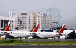 Fleet of Philippine Airlines' passenger planes park on the tarmac Saturday, July 31, 2010 at Manila's international airport, Philippines. (AP/Pat Roque)