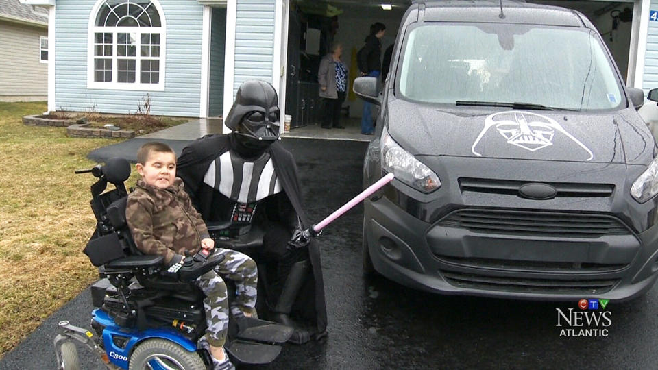 "A young boy with a fatal muscular disease will be travelling to school in style on Monday, on board his family's new decked-out ""Darth Vader"" van."