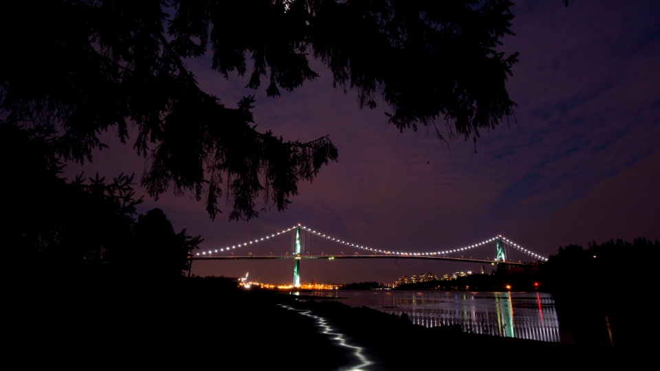 The lights on the Lions Gate bridge are on prior to Earth Hour as seen from West Vancouver, Saturday, March, 23, 2013. (Jonathan Hayward /  THE CANADIAN PRESS)