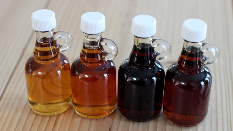 This March 9, 2015 photo shows a maple syrup sampler Grade A Light Amber, Grade A Medium Amber, Grade A Dark Amber, Grade B in Concord, N.H. (Matthew Mead / The Canadian Press)