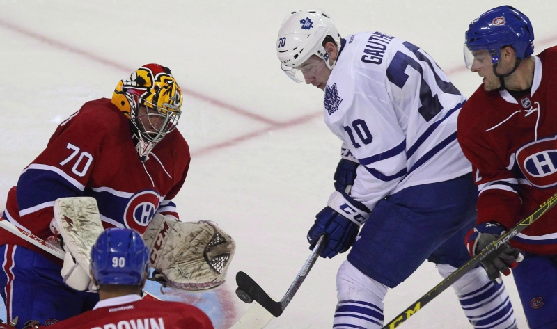 Montreal Canadiens goalie Michael McNiven stops tipped shot by Toronto Maple Leafs' Frederik Gauthier during third period action at the 2015 NHL Rookie Tournament on September 12, 2015 in London, Ont. (Dave Chidley / The Canadian Press)