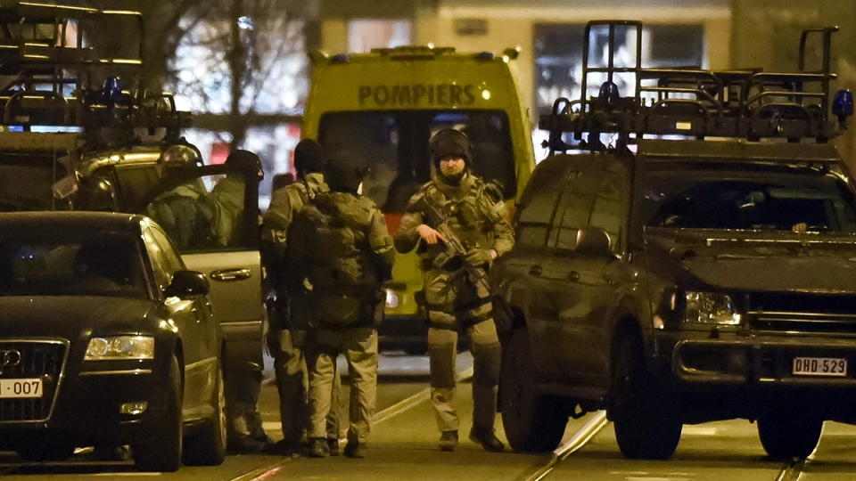 Special operations police take positions during a raid in Brussels on Tuesday, March 15, 2016. (AP / Geert Vanden Wijngaert)