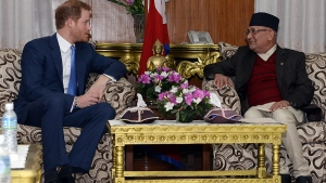 Prince Harry, left, and Nepalese Prime Minister Khadga Prasad Sharma Oli talk during a meeting at the Prime Minister residence in Kathmandu, Nepal, Saturday, March 19, 2016. (Salikram Koirala / Nepal's Department Of Information via AP)