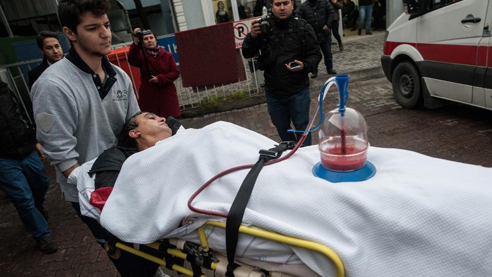 A Turkish medic pulls Abraham Rahmi, an Israeli tourist, into Sisli Etfal Hospital close the scene of an explosion, in Istanbul, Turkey, Saturday, March 19, 2016. (Depo Photos via AP )