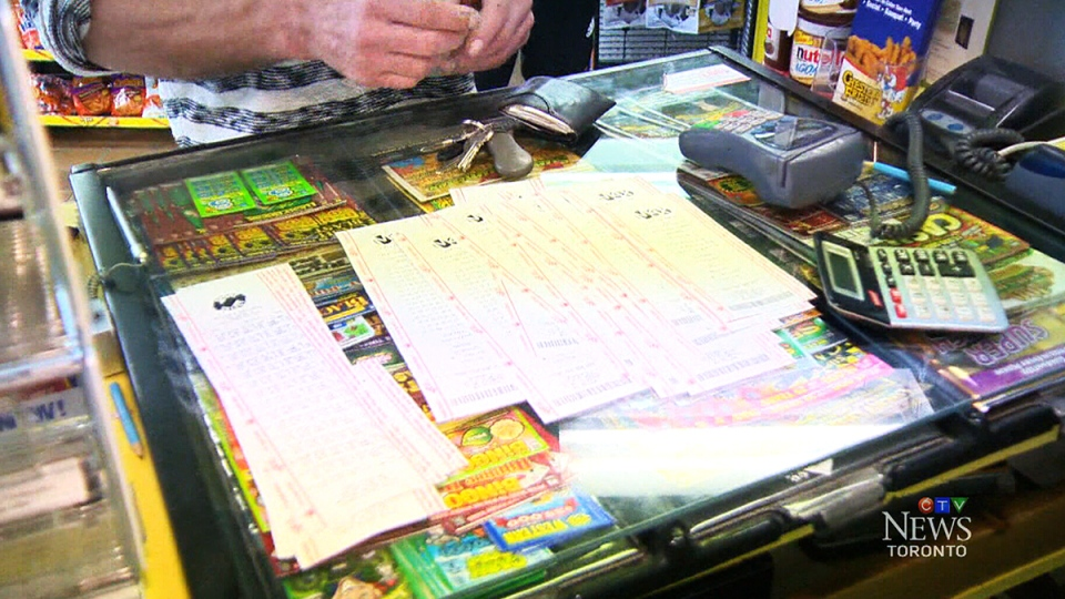 Customers purchase a number of Lotto Max tickets in Toronto.