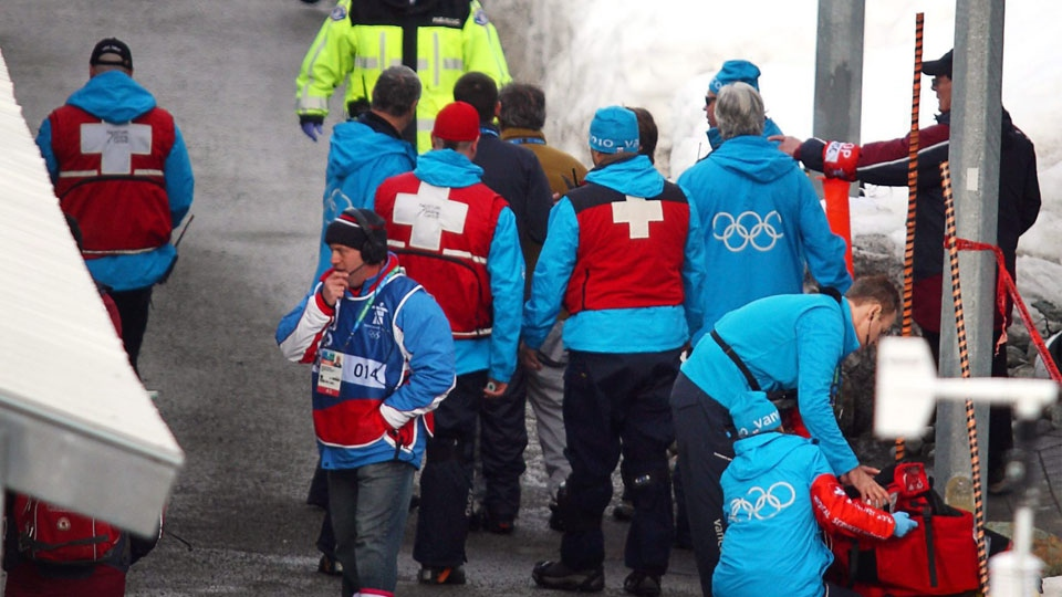 In this file photo, track volunteers and medical workers pack their gear follwoing the crash Georgian luger Nodar Kumaritashvili during men's luge training, Friday, Feb. 12, 2010 (THE CANADIAN PRESS/Jeff McIntosh)