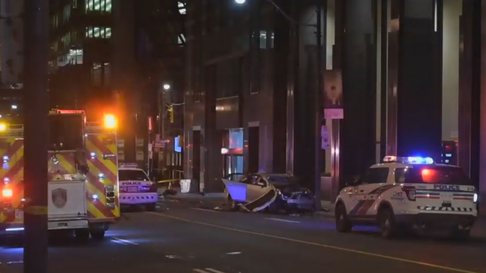 Eight people are in hospital after a two-vehicle crash in the Financial District early Sunday morning.
