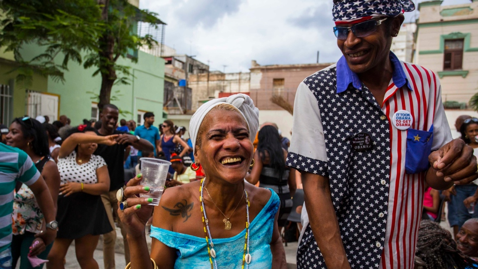 Two Cubans smile widely as they take part in a weekly rumba dance gathering in Havana, Cuba, Saturday, March 19, 2016. (AP / Desmond Boylan)