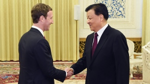 In this March 19, 2016 photo provided by China's Xinhua News Agency, Liu Yunshan, right, a member of the Politburo Standing Committee, the ruling Communist Party's top leadership panel, meets with Facebook founder and CEO Mark Zuckerberg in Beijing, capital of China. (Wang Ye/Xinhua News Agency via AP)