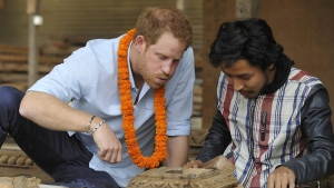 Britain's Prince Harry tries wood carving heritage sites at Patan Durbar Square on the outskirts of Kathmandu, Nepal, Sunday, March 20, 2016. (Prakash Mathema via AP)