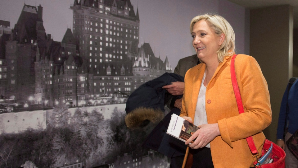 France Front National Leader Marine Le Pen leaves a news conference, Sunday, March 20, 2016 in Quebec City. (Jacques Boissinot / THE CANADIAN PRESS)