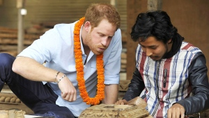 Britain's Prince Harry tries wood carving heritage sites at Patan Durbar Square on the outskirts of Kathmandu, Nepal, Sunday, March 20, 2016. Harry began a five-day official trip to Nepal on Saturday, meeting with Prime Minister Khadga Prasad Oli and attending a ceremony to mark 200 years of relations between the two nations. (Prakash Mathema / AP)