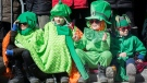 Young members of the crowd take in the annual Saint Patrick's parade in Montreal, Sunday, March 20, 2016. THE CANADIAN PRESS/Graham Hughes