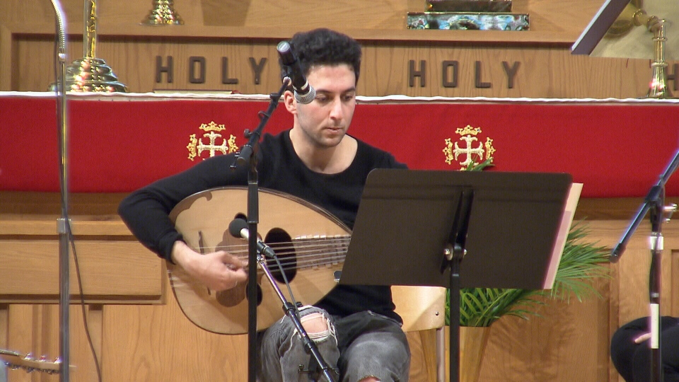 Farooq Al-Sajee, 24, fled from Iraq to Syria to Canada - but has kept his love of music alive. March 20, 2016. (CTV News).