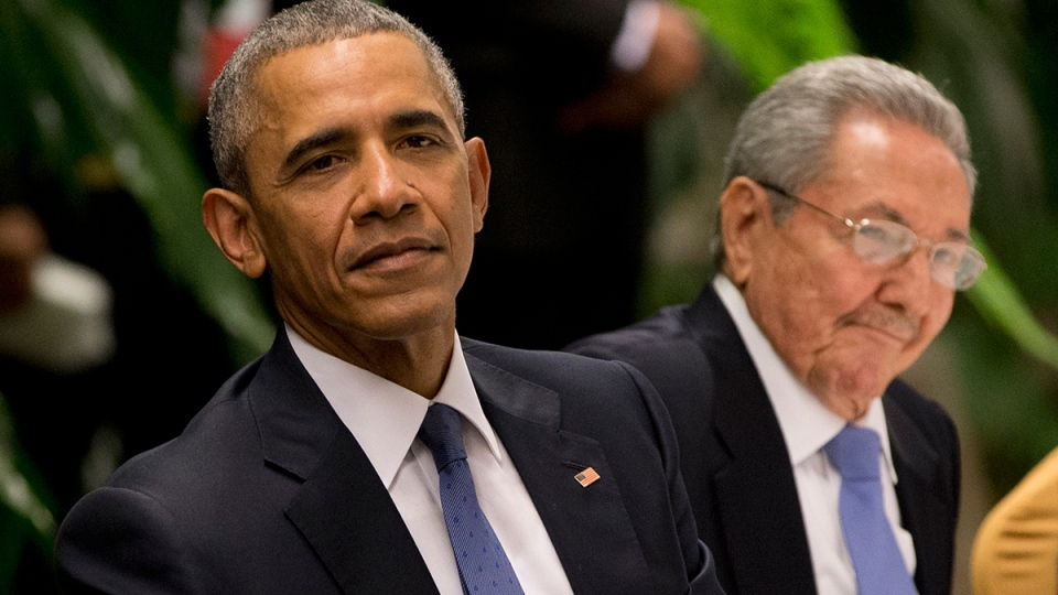 U.S. President Barack Obama, left, listens to a live band along with Cuba's President Raul Castro during a state dinner at the Palace of the Revolution in Havana, Cuba, Monday, March 21, 2016. (AP / Rebecca Blackwell)