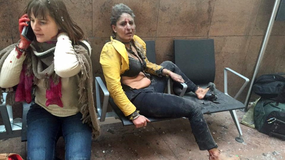 In this photo provided by Georgian Public Broadcaster and photographed by Ketevan Kardava, two women wounded in Brussels Airport in Brussels, Belgium, after explosions on March 22, 2016. (Ketevan Kardava/ Georgian Public Broadcaster via AP)
