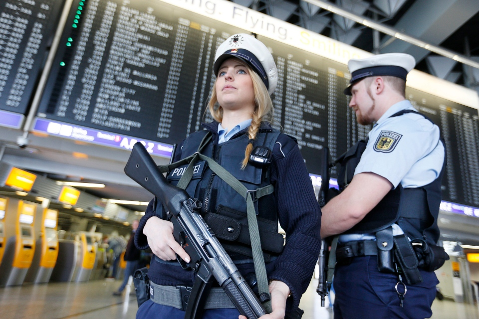 German police officers guard a terminal of the airport in Frankfurt, Germany, Tuesday, March 22, 2016. (AP / Michael Probst)