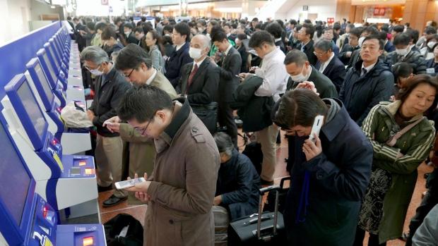 Crowds at Haneda Airport in Tokyo, Japan