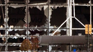 The blown out windows of Zaventem airport are seen after a deadly attack in Brussels, Belgium, Tuesday, March 22, 2016.  (AP Photo/Peter Dejong)