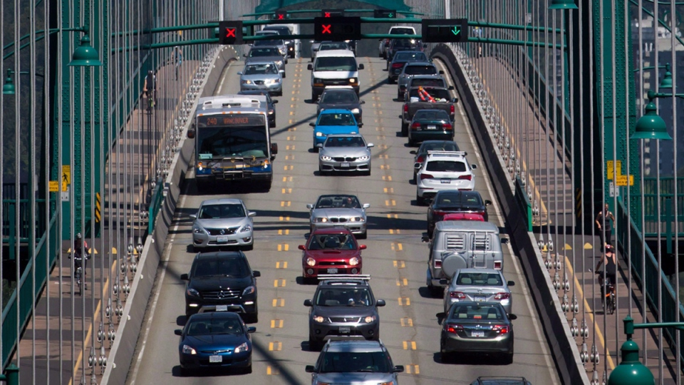 Traffic crosses over the Lions Gate Bridge from North Vancouver into Vancouver, B.C., on  July 2, 2015.  (Darryl Dyck / THE CANADIAN PRESS)