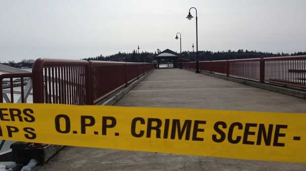 Police tape blocks off access to an OPP administration building in Kenora and a nearby marina.