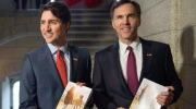 Prime Minister Justin Trudeau, left, poses with Minister of Finance Bill Morneau as he arrives to table the budget on Parliament Hill, Tuesday, March 22, 2016 in Ottawa. (Justin Tang / THE CANADIAN PRESS)