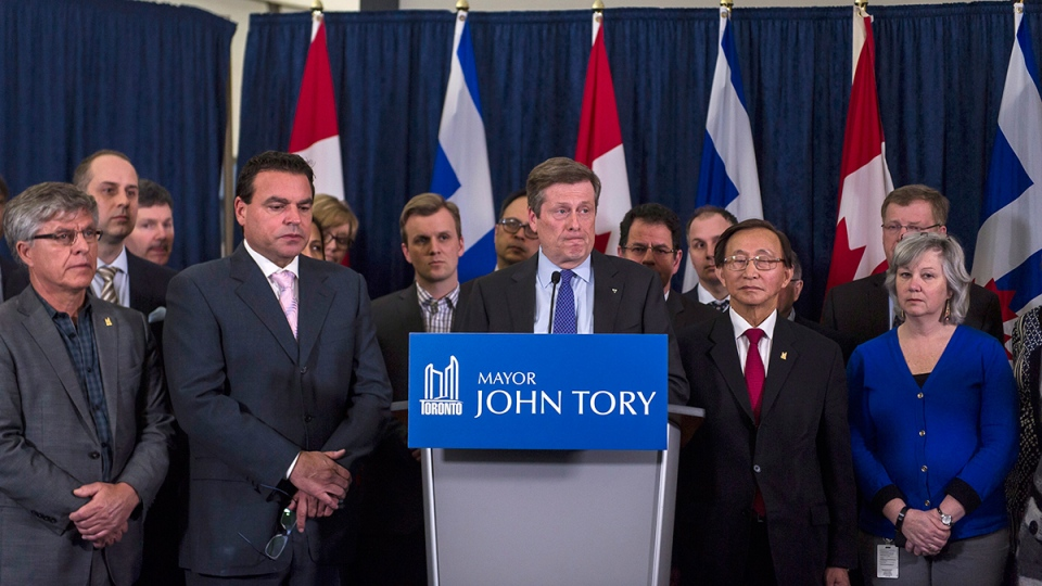 Toronto Mayor John Tory (centre) addresses a press conference on the death of former mayor Rob Ford at City Hall in Toronto, Tuesday, March 22, 2016. (Christopher Katsarov / THE CANADIAN PRESS)