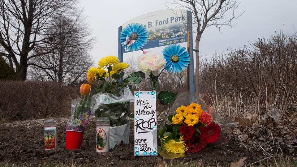 Flowers are left at Douglas B. Ford Park in Etobicoke, named after Rob Ford's father, on Tuesday, March 22, 2016. (Chris Young / THE CANADIAN PRESS)