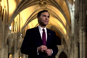 Minister of Finance Bill Morneau takes part in media interviews in the foyer of the House of Commons after delivering the federal budget on Parliament Hill in Ottawa on March 22, 2016. (Adrian Wyld/ The Canadian Press)