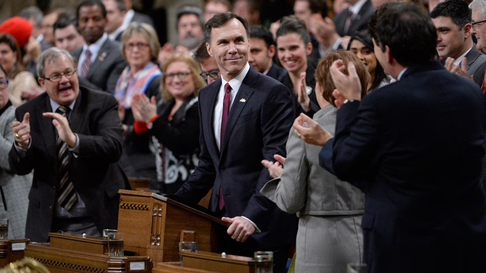 Minister of Finance Bill Morneau is given a standing ovation as he arrives to deliver the federal budget in the House of Commons on Parliament Hill in Ottawa on Tuesday, March 22, 2016. (Adrian Wyld / THE CANADIAN PRESS)