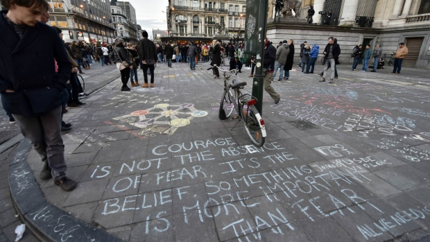 Brussels residents mourn victims of attacks