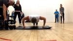 Alan Waselenchuk performs knuckle push-ups
