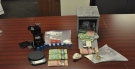 Weapons, drugs and cash seized by London Police during raids on March 23, 2016 (Courtesy: London Police)