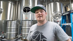 Joshua Counsil, co-founder of Good Robot Brewing Co., stands in the brewing area of their operation in Halifax, N.S., on Wednesday, March 23, 2016. (THE CANADIAN PRESS/Andrew Vaughan)
