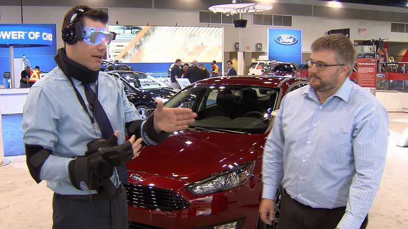 CTV News reporter Ben Miljure tests out a suit that mimics the sensation of driving under the influence of various drugs at the Vancouver Auoto Show. March 23, 2016.