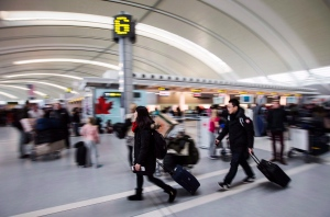 People carry luggage at Pearson International Airport in Toronto on Dec. 20, 2013. (Mark Blinch / THE CANADIAN PRESS)