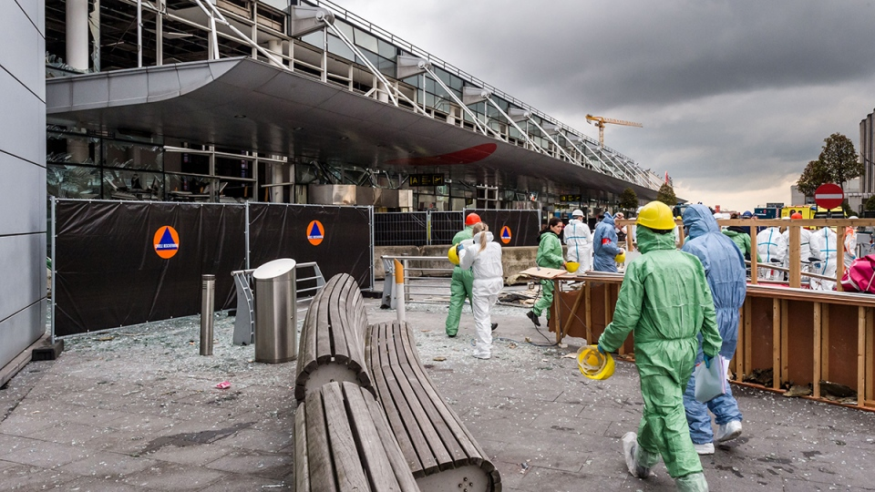 Forensic officers work in front of the damaged Zaventem Airport terminal in Brussels on Wednesday, March 23, 2016. (AP / Geert Vanden Wijngaert)