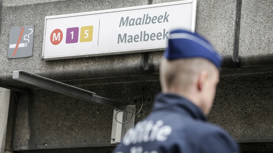 A Belgian police officer stands at the entrance to Maelbeek metro station in Brussels on Wednesday, March 23, 2016. (AP / Thierry Roge)
