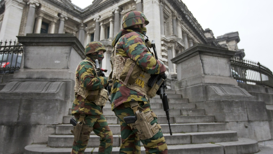 Belgium soldiers patrol around the main court building where Salah Abdeslam, the top suspect in last year's deadly Paris attacks, was expected to appear before a judge in Brussels, Belgium, Thursday, March 24, 2016. (AP / Peter Dejong)