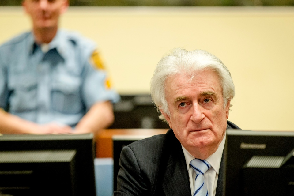 Bosnian Serb wartime leader Radovan Karadzic in the courtroom for the reading of his verdict at the International Criminal Tribunal for Former Yugoslavia (ICTY) in The Hague, The Netherlands Thursday March 24, 2016. (Robin van Lonkhuijsen, Pool via AP)