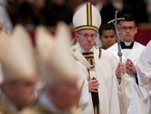 Pope Francis leaves at the end of a Chrism Mass in St. Peter's Basilica at the Vatican Thursday, March 24, 2016. During the Mass the Pontiff blessed a token amount of oil that will be used to administer the sacraments for the year. (AP Photo/Alessandra Tarantino)